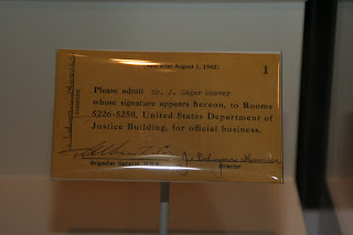 Pass signed by J. Edgar Hoover approving his attendance at 1942 trial of Nazi saboteurs on display at Newseum. Trial pass for J. Edgar Hoover, 1942. 2010.11. Collection of the National Law Enforcement Museum, Washington, D.C.