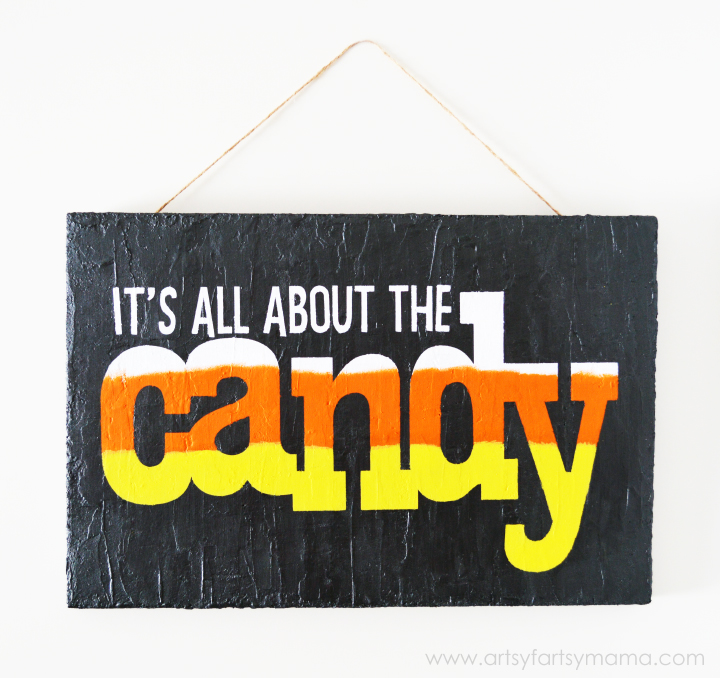 "Halloween ""It's All About the Candy"" Sign at artsyfartsymama.com #MakeItFunCrafts"