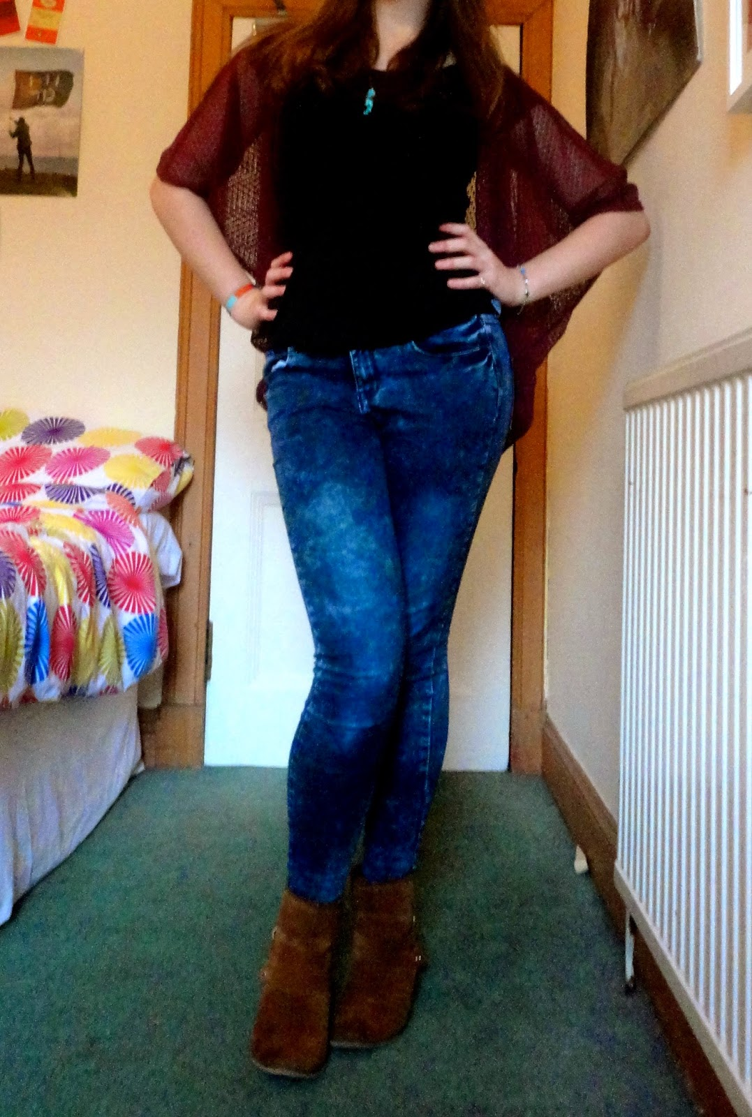 Outfit of purple string cardigan, black tshirt, jeans, and brown ankle boots