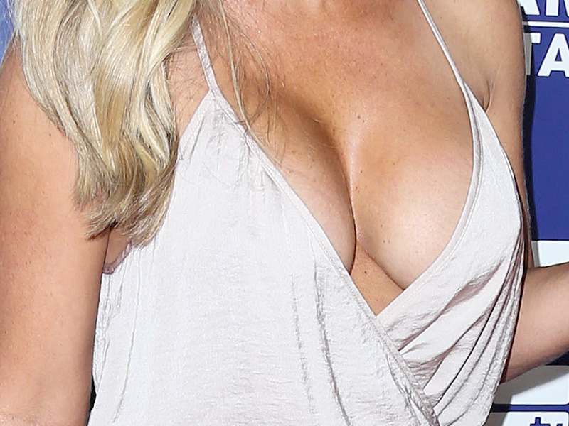 Kendra Wilkinson hot braless cleavage in a low-cut dress
