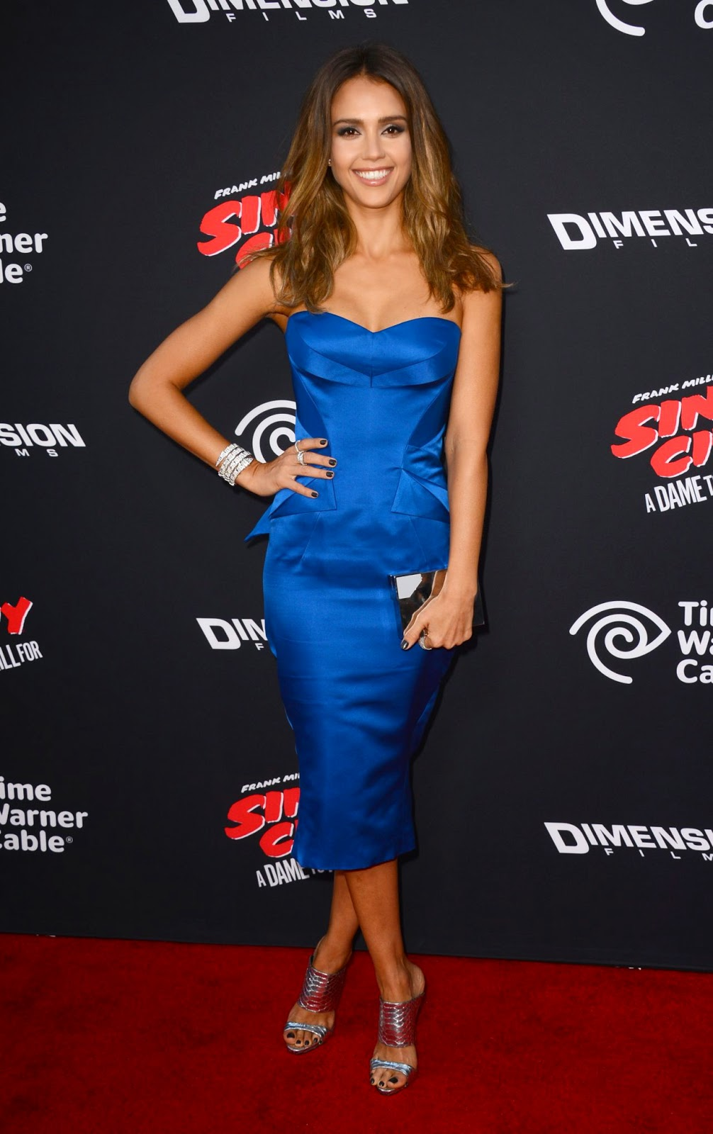 Jessica Alba sizzles in a strapless Zac Posen dress at the 'Sin City: A Dame to Kill For' LA premiere