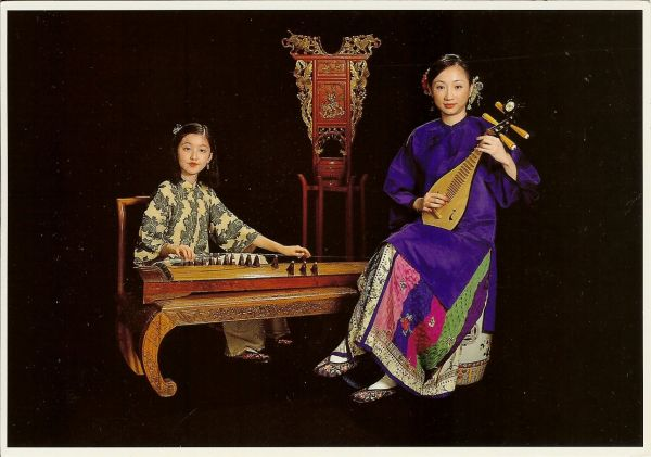 young women in Chinese costumes with old musical instruments
