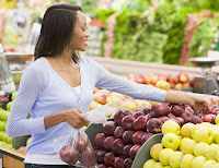 Woman selecting apples at the grocery store