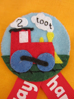felt baby safe birthday badge stitching close up