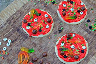 creepy cookie pizzas on a table