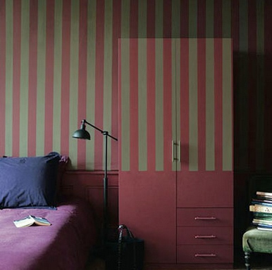 [A striped wall with a matching closet that blends with it]