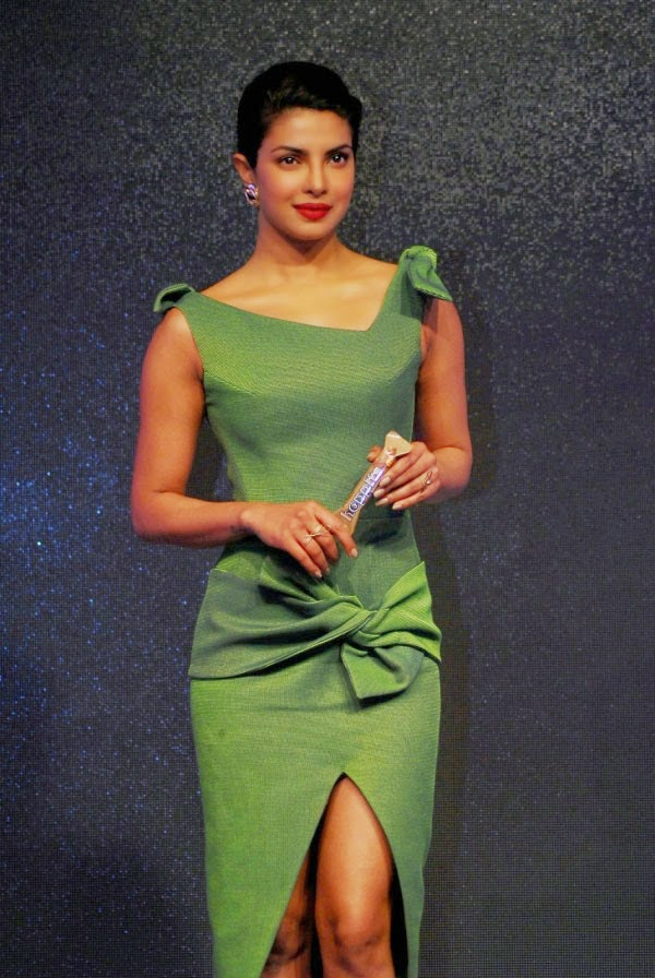 Priyanka Chopra in deep front cut green dress showing her thighs
