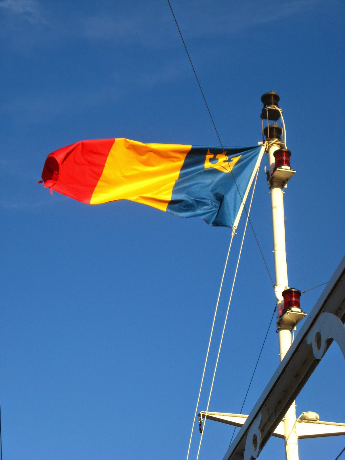 Queen's University flag on a ship's mast