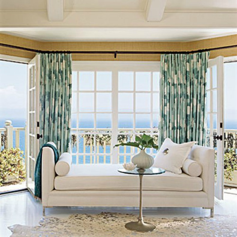 White day bed in coastal bedroom with and ocean view