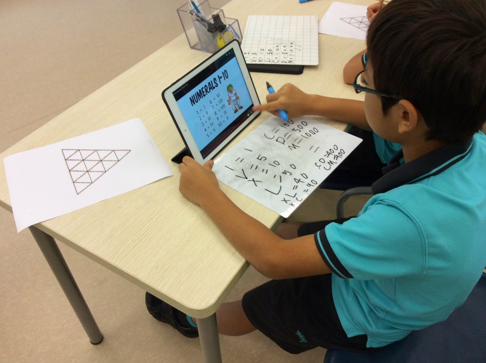 independent learning year nais hk jojo working independently to select notes to help him create his tarsia puzzle