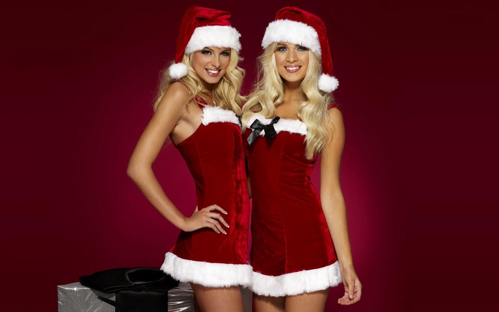 Chicas vestidas de Santa Claus muy navideñas