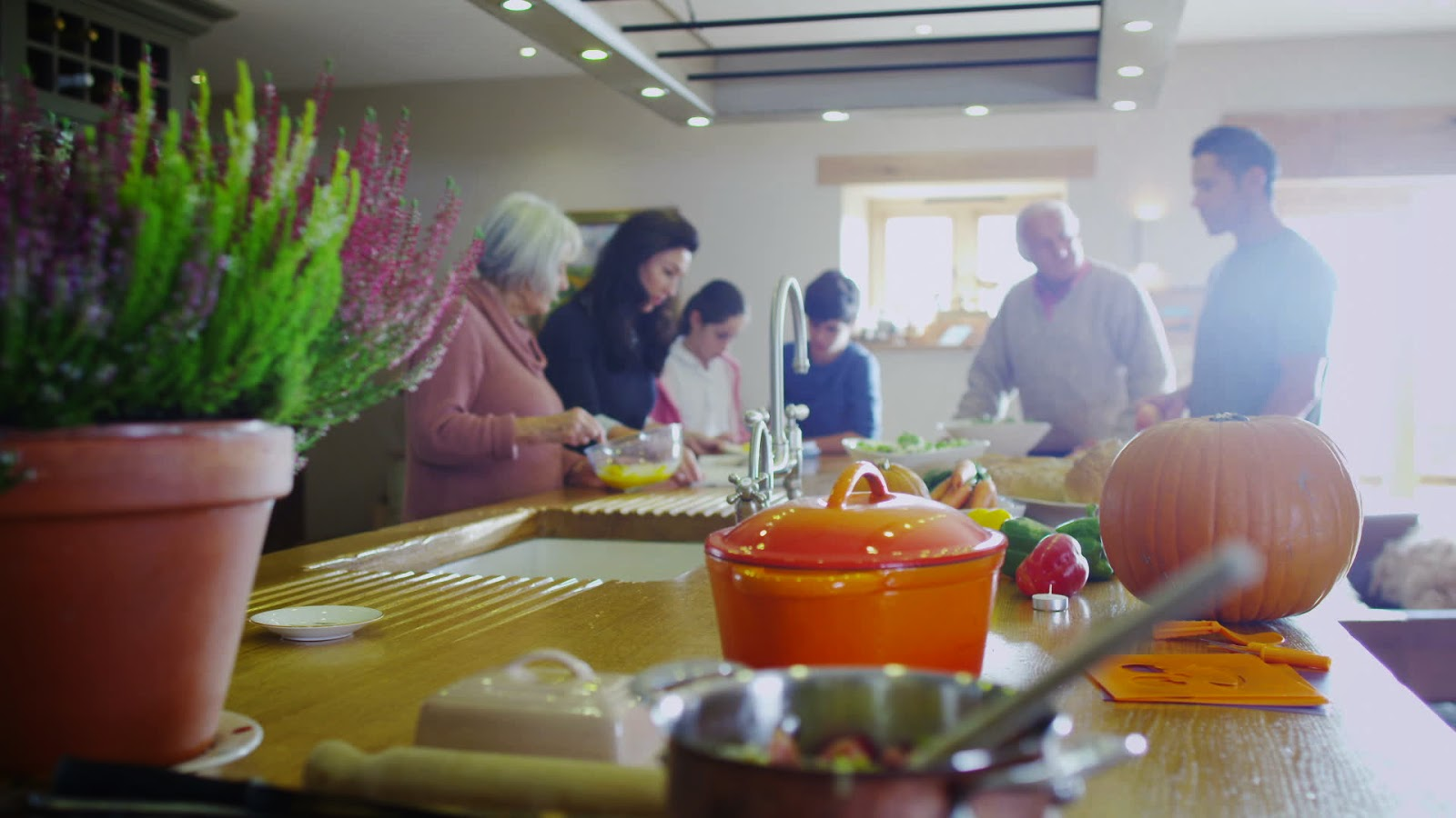 Family preparing a meal together in silence