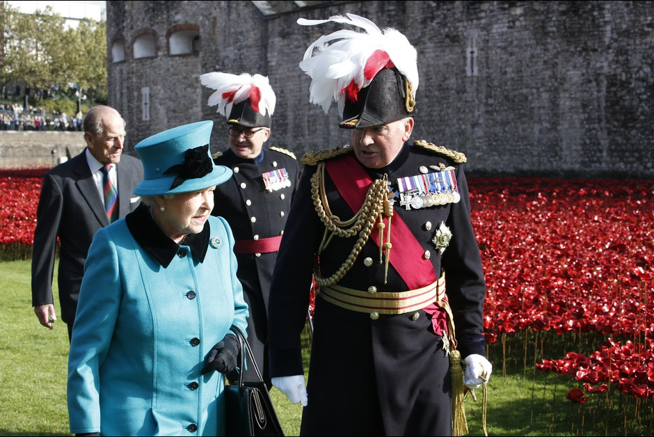 Queen Elizabeth II and Prince Philip, Duke of Edinburgh visit the Blood Swept Lands and Seas of Red evolving art installation at the Tower of London