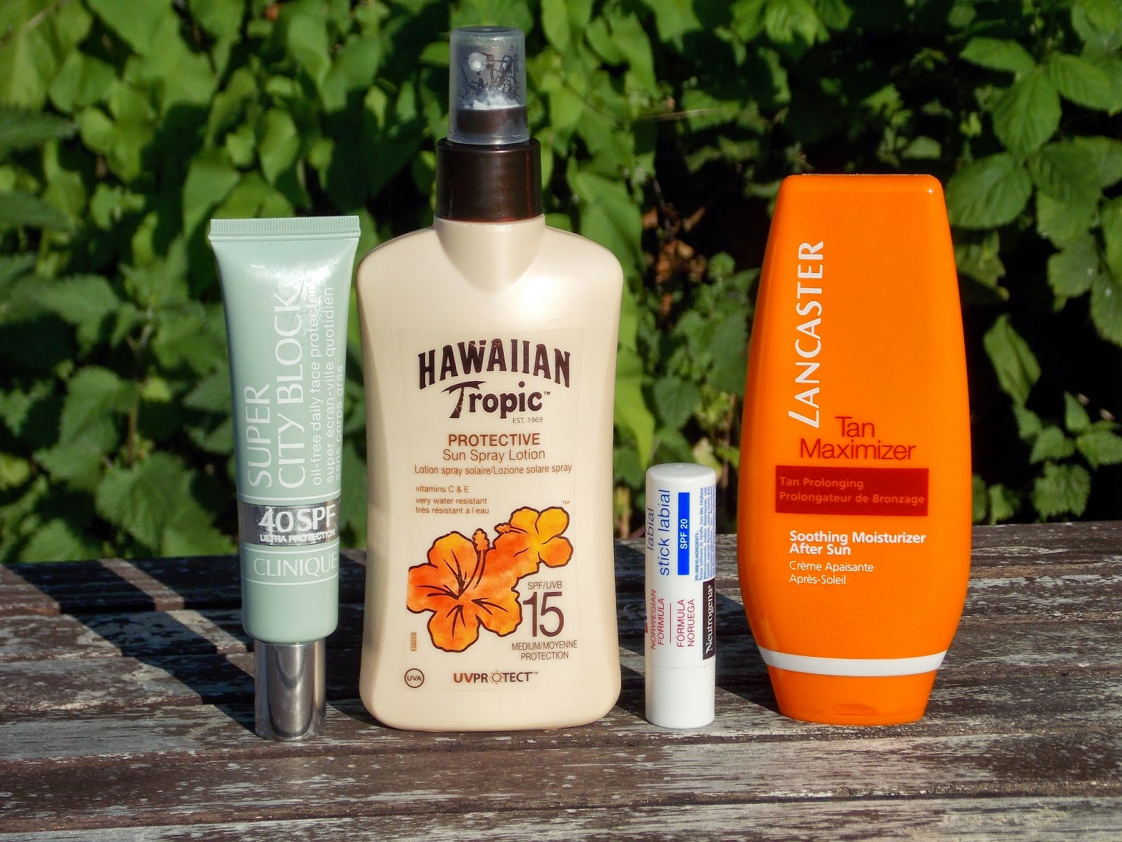 Clinique Super City Block SPF40, Hawaiian Tropic Protective Sun Spray Lotion SPF15, Neutrogena Norwegian Formula Lip Balm SPF20, Lancaster Tan Maximiser