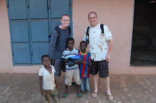 Nathan Henshaw and a fellow student with some Ghana children during their time with the SEED program.