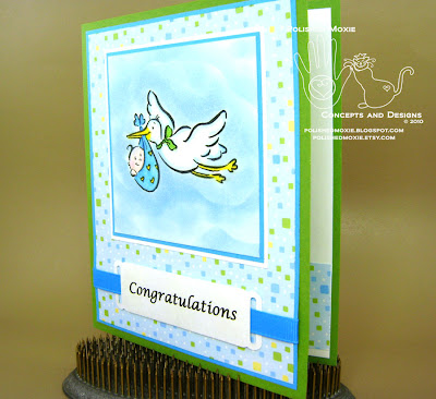 Picture of my stork baby card sitting at a left angle to show dimensional elements