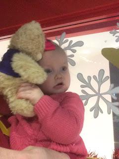 Baby Girl cuddling teddy bear