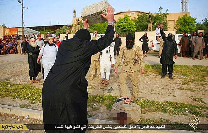 ISIS Terror group smashes thieves' heads with concrete blocks
