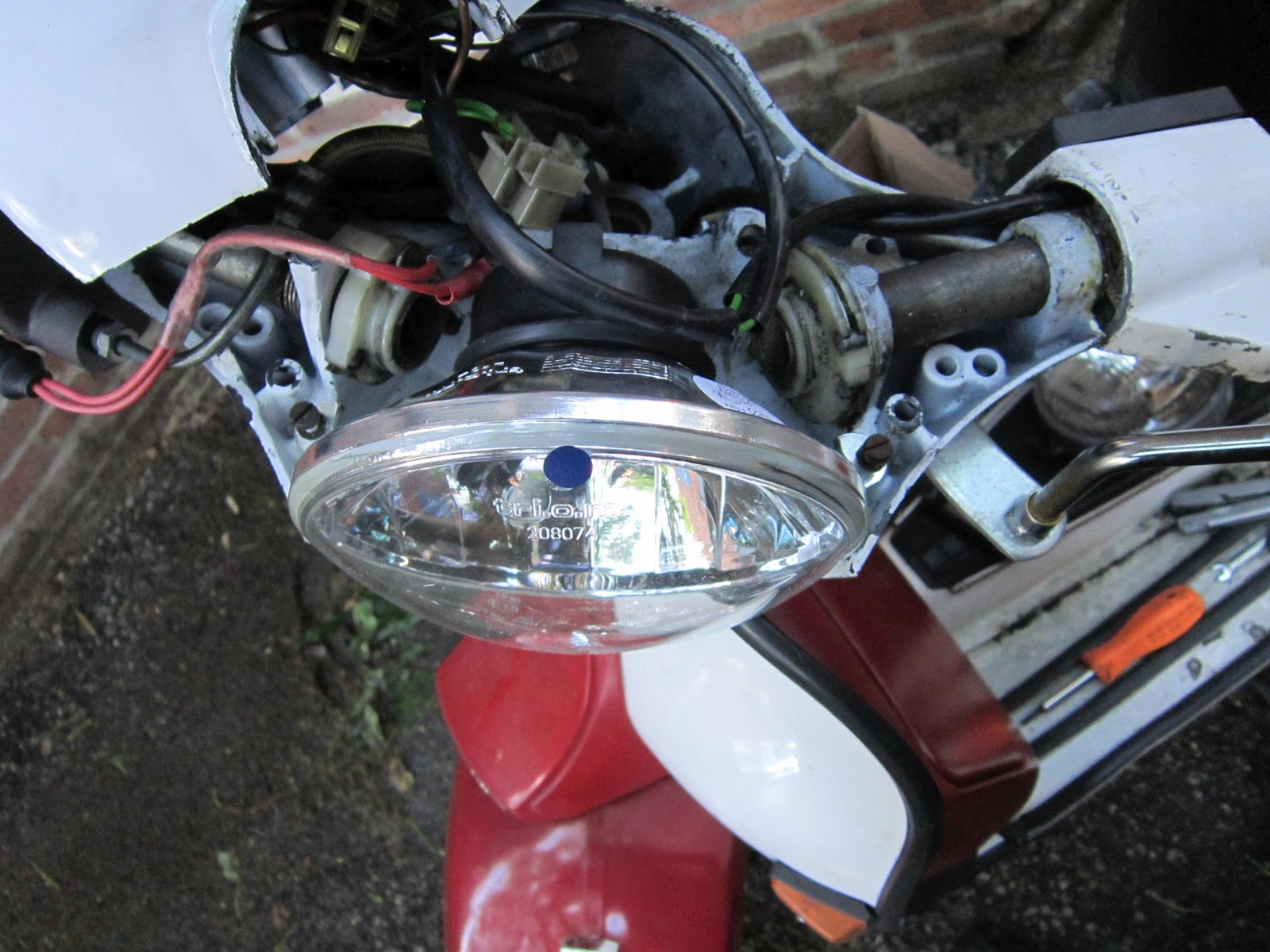 Vespafrog Vespa Px125e Wiring Diagram The Screw For Locking Vertical Aim Of Headlight Uses A Different Hole On Px While It Used To Go Through Marked With Red