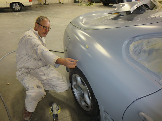 Body technician finishing dent repairs on 1995 Toyota Supra at Almost Everything Auto Body