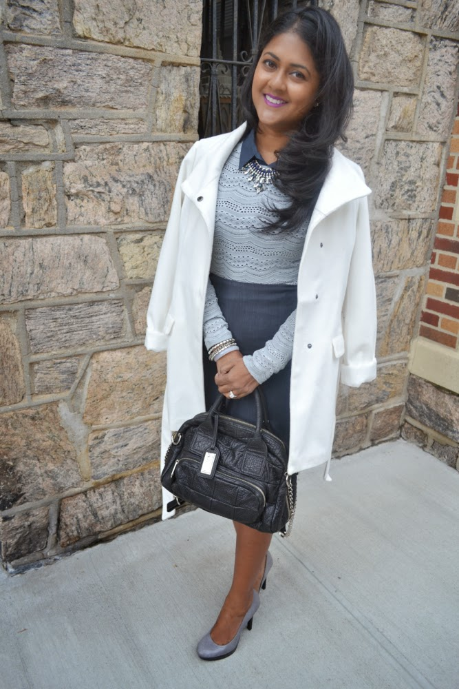 white coat, blue skirt, blue statement necklace