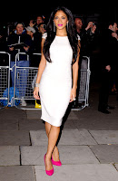 Nicole Scherzinger in a white dress and pink heels