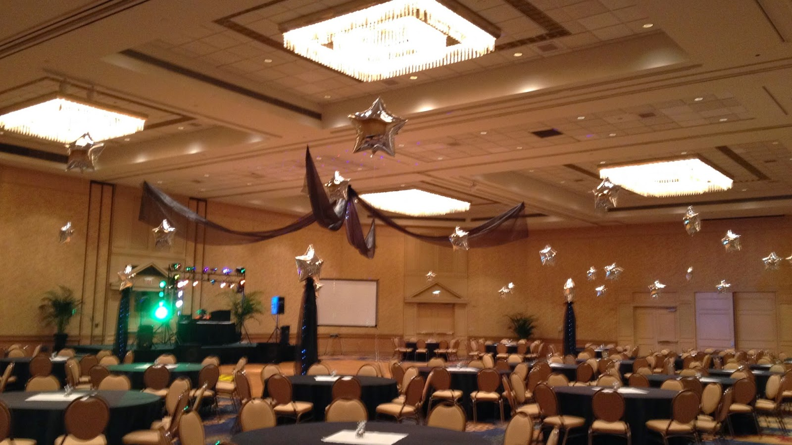 Silver stars above each table fill the room with a star filled sky!