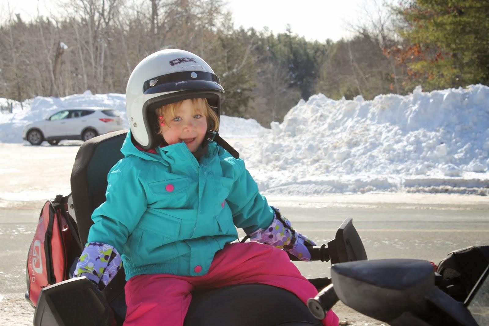 kids snowmobiling
