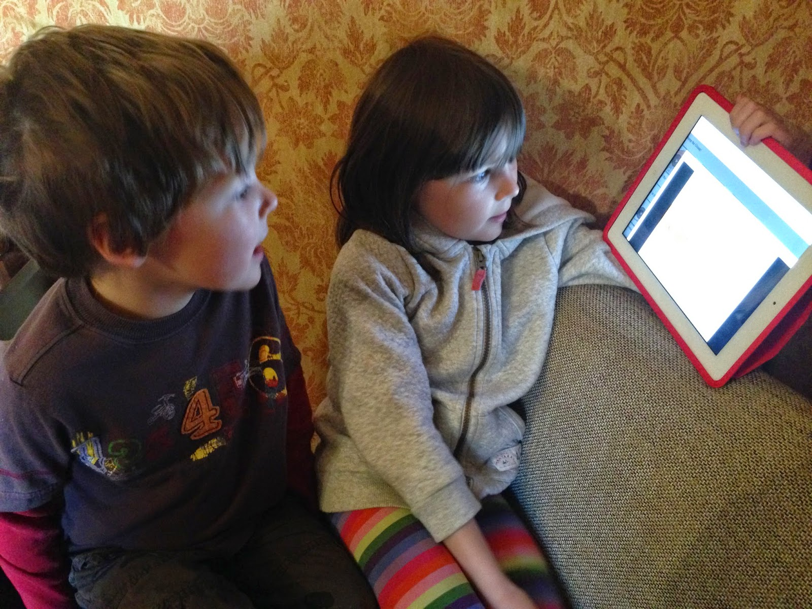 Siblings with ipad