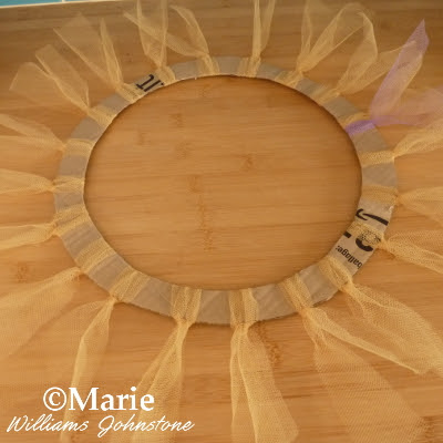 Gold color netting fastened around a wreath