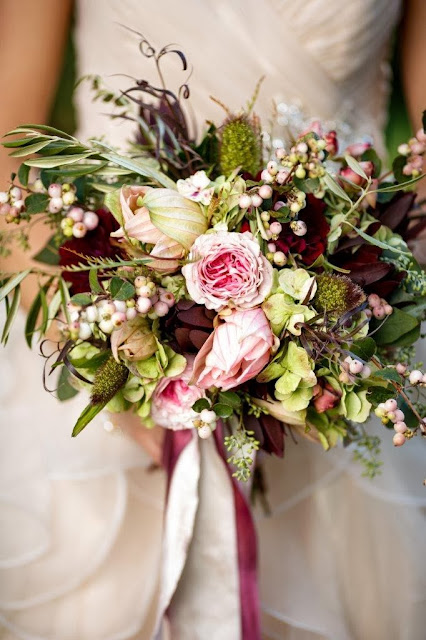 Isha Foss Events Fall bouquet of Garden roses, Dahlias, leucadendron, snow berry, millet, olive branch, and seeded eucalyptus.