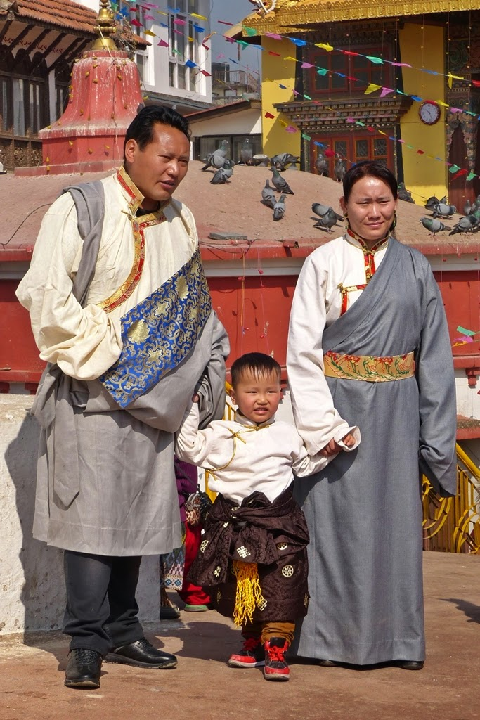 Tibetan family wearing traditional costumes