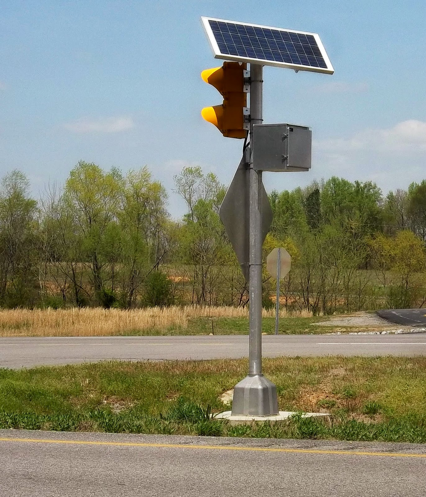 Practical parsimony solar powered traffic signal