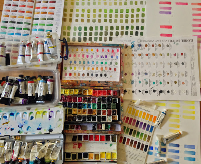 Photograph of watercolour paints and colour charts