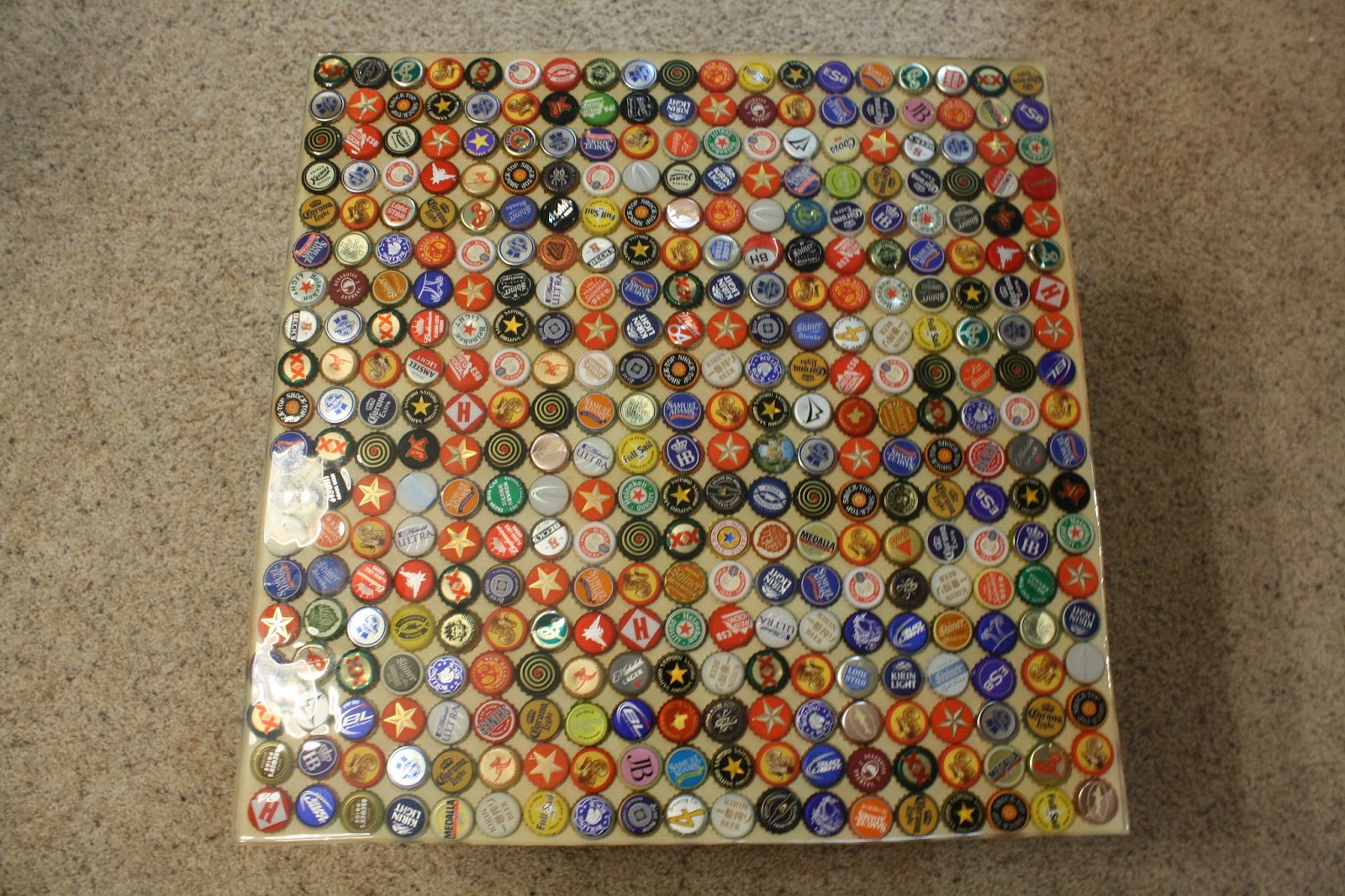 Everything helvatica bottle cap table top for What to make with beer bottle caps