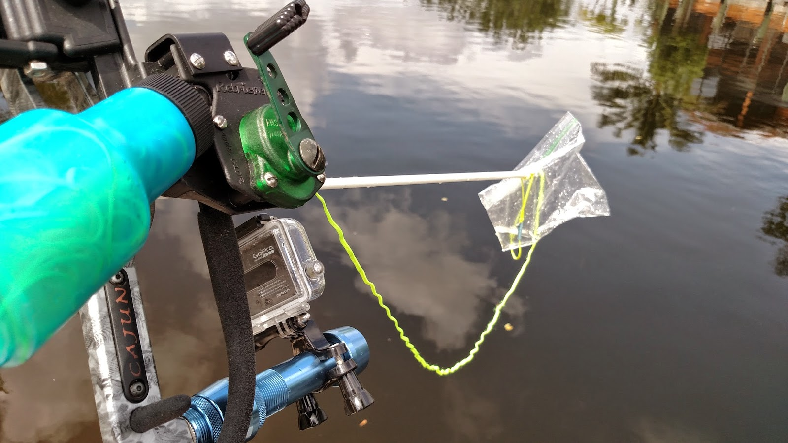 Shooting floating litter in a Cape Coral Canal with a Bowfishing bow.