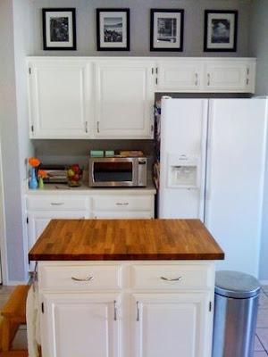 mylittlehousedesign.com framed art above kitchen cabinets