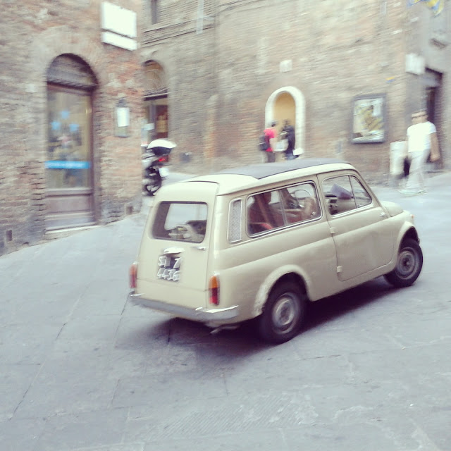 Driving in Siena: small is beVespa parking in Siena's town center autiful