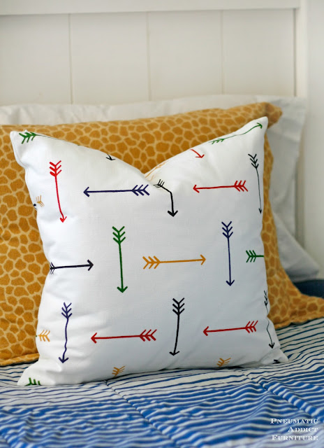 Use a paint-a-pillow kit to make a multi colored arrow pillow