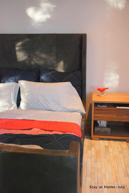 Restoration Hardware Leather sleigh bed, hide rug, west elm bedding