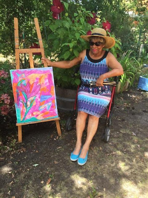 artist Shirley Monestier in her garden with work in progress -  ABSTRACT SUMMER GARDEN