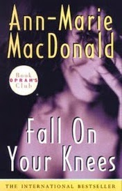 Cover of Fall On Your Knees, featuring a blurry black and white photo of a dark-haired woman with her left hand raised to her face.