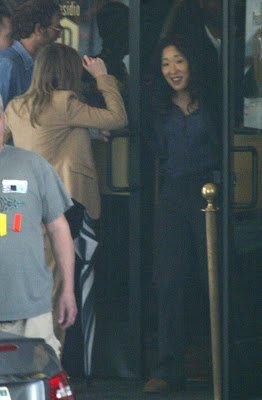 sandra oh  and ellen pompeo on the grey's anatomy set