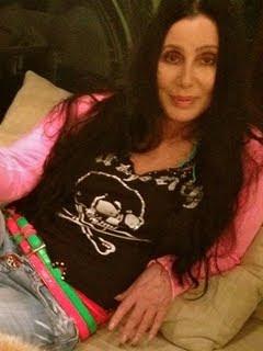 Cher lies back