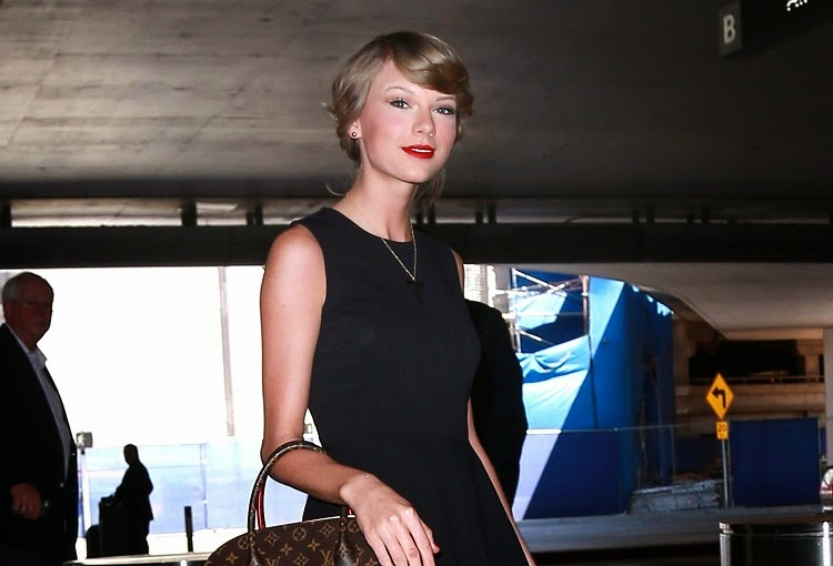 Taylor Swift shows off long legs in a flirty dress at LAX Airport