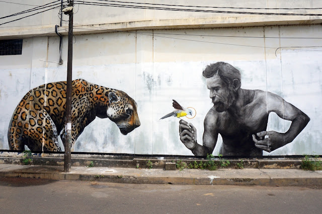 Evoca1 Mural Cheetah, Man And Bird in Tarapoto