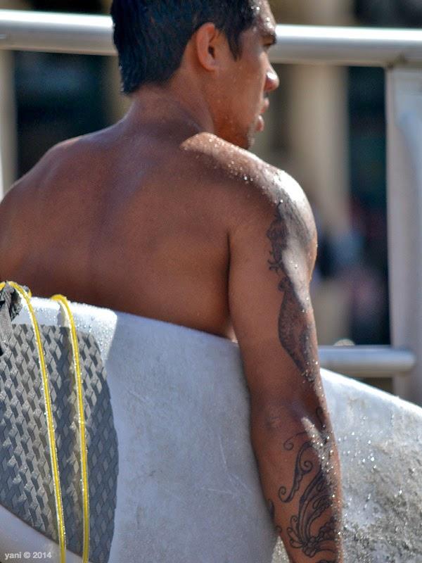 surfer tattoo arm