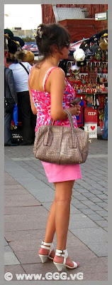 Girl in pink skirt on the street