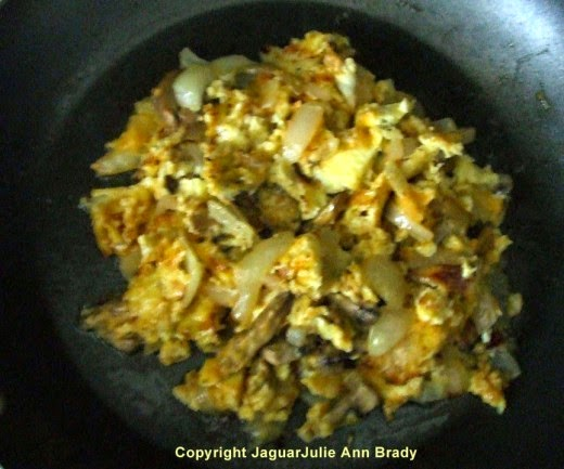 step four Cheesy Scrambled Eggs with Mushrooms and Onions