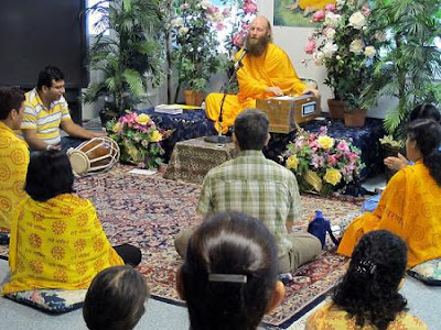 Devotees of Kripaluji Maharaj experiencing the bliss of kirtan